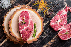 Raw juicy meat steak on dark wooden background ready to roasting Stock Photo