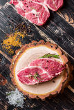 Raw juicy meat steak on dark wooden background ready to roasting Royalty Free Stock Photography