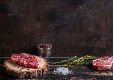 Raw juicy meat steak on dark wooden background ready to roasting Stock Photos