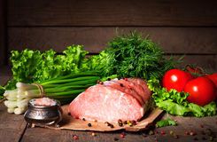 Raw juicy meat steaks ready for roasting on a black chalk board. Royalty Free Stock Image