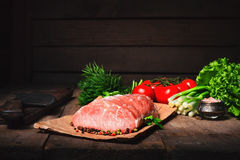 Raw juicy meat steaks ready for roasting on a black chalk board. Royalty Free Stock Photo