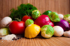 Raw juicy vegetables on natural background. Raw juicy vegetables on the background of wooden elements royalty free stock photos