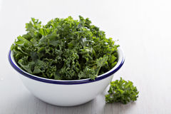 Raw kale in a bowl. Raw fresh green kale cut to pieces in a bowl Stock Images