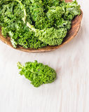 Raw  kale preparation on white wooden. Table Stock Photography