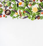 Raw kale with vegetables ingredients for healthy cooking and spoon on white wooden background, top view. Border Stock Image