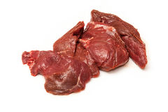 Raw kangaroo meat steaks. Pile of raw kangaroo meat steaks isolated on a white background Stock Image