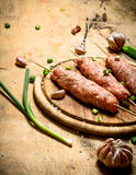 Raw kebab of beef with garlic and onions. On a wooden table Royalty Free Stock Photos
