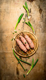 Raw kebab of beef with garlic and onions. On a wooden table Stock Photos