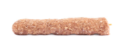 Raw kebab meat on a stick. Isolated over the white background Royalty Free Stock Image
