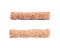 Raw kebab meat on a stick. Isolated over the white background, set of two different foreshortenings Stock Photography