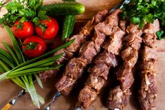Raw kebab with onion on wooden board Stock Photo