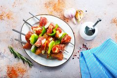 Raw kebab. On plate and on a table Stock Photo