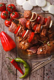 Raw kebab in a spicy marinade on skewers close-up. vertical top Royalty Free Stock Photos