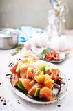 Raw kebab. With vegetables on meta plate Stock Photo