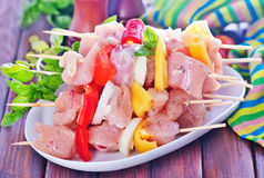 Raw kebab. With vegetables on the plate Stock Image