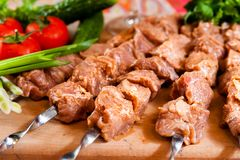 Raw kebab on wooden board Stock Photography