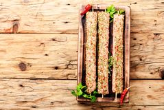 Raw kebabs in skewers. Caucasian popular dish, kebab from young lamb meat and spices.Fast food Royalty Free Stock Photo