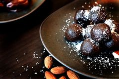 Raw keto dessert, cocoa and almond truffles stock photos