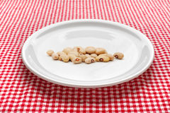Raw kidney beans on plate Stock Photo