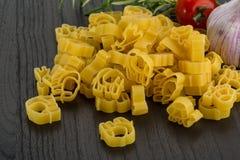 Raw kids pasta Stock Photo