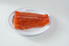 Raw King Salmon. Side top view of raw wild king Salmon Fillet lying on white place, against white background Royalty Free Stock Image