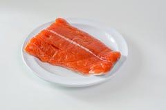 Raw King Salmon. Raw wild king Salmon Fillet lying on white place, against white background Stock Image
