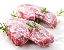 Raw lamb chops. Two raw fresh lamb chops with rosemary herb stock photography