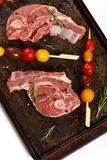 Raw Lamb Chops. With cherry tomato and rosemary herb ready to cook. Selective focus Stock Images