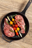 Raw Lamb Chops. With cherry tomato and rosemary herb ready to cook. Selective focus Royalty Free Stock Photo