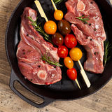 Raw Lamb Chops. With cherry tomato and rosemary herb ready to cook. Selective focus Royalty Free Stock Images
