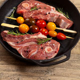 Raw Lamb Chops. With cherry tomato and rosemary herb ready to cook. Selective focus Royalty Free Stock Photos
