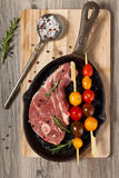 Raw lamb chops. With cherry tomato and rosemary herb ready to cook. Selective focus Stock Image