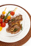 Raw Lamb Chops. With cherry tomato and rosemary herb. Selective focus Royalty Free Stock Image