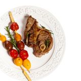 Raw Lamb Chops. With cherry tomato and rosemary herb. Selective focus Stock Photography
