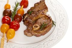 Raw Lamb Chops. With cherry tomato and rosemary herb. Selective focus Royalty Free Stock Images