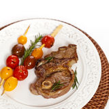 Raw Lamb Chops. With cherry tomato and rosemary herb. Selective focus Stock Photo