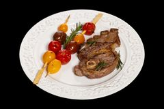 Raw Lamb Chops. With cherry tomato and rosemary herb. Selective focus Royalty Free Stock Photo