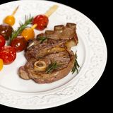 Raw Lamb Chops. With cherry tomato and rosemary herb. Selective focus Stock Image