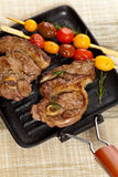 Raw Lamb Chops. With cherry tomato and rosemary herb. Selective focus Stock Photos