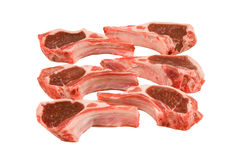 Raw lamb chops isolated on white. Closeup of raw lamb chops isolated on white Royalty Free Stock Image