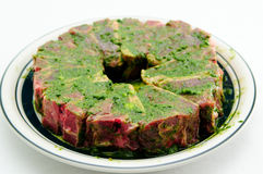 Raw lamb chops marinading. In mint and oil Stock Photo