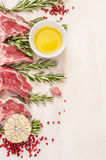 Raw  lamb chops with oil and spices, preparation on white wooden background. Frame, place for text Stock Images
