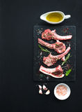 Raw lamb chops. Rack of Lamb with garlic, rosemary Stock Photo