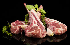Raw lamb chops with spices and herbs. Isolated on black background Royalty Free Stock Photography