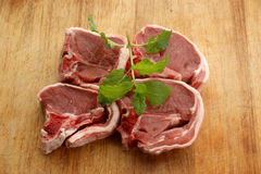 Raw lamb chops on a timber board Royalty Free Stock Photos