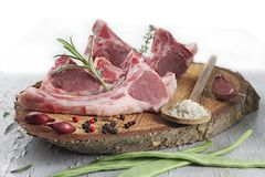 Raw lamb cutlets with rosemary Stock Image