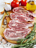 Raw lamb cutlets with vegetables, herbs and spices Stock Photos