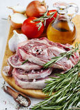 Raw lamb cutlets with vegetables, herbs and spices Stock Image