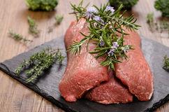 Raw lamb fillet with herbs Royalty Free Stock Photo