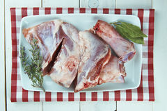 Raw lamb leg on the table of the kitchen Stock Photography